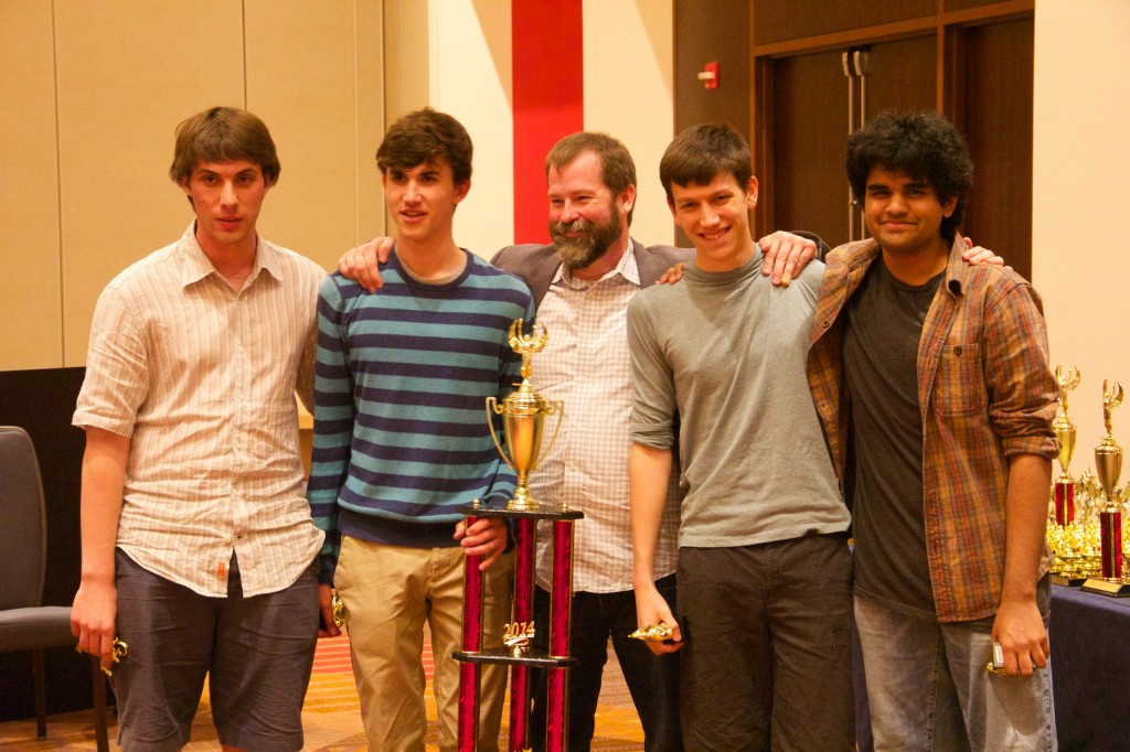 The members of the 2014 HSNCT Champion LASA A team along with their coach, Jason Flowers. All four were students at Texas Quiz Bowl Camp in years past.